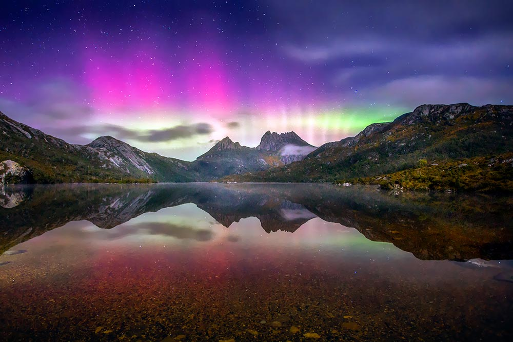 things to do in cradle mountain - the famous aurora australis lights over cradle mountain and dove lake