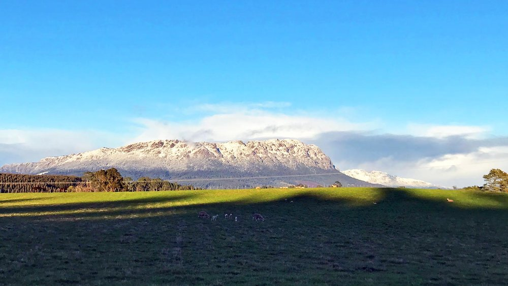things to do in cradle mountain - mount roland sheffield with a dusting of snow