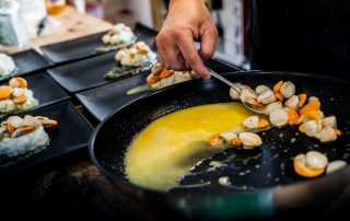 best food in cradle mountain - scallops in a butter sauce served from a frying pan