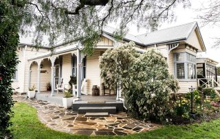 cradle mountain where to stay - glencoe country b&b porch and colonial-style building